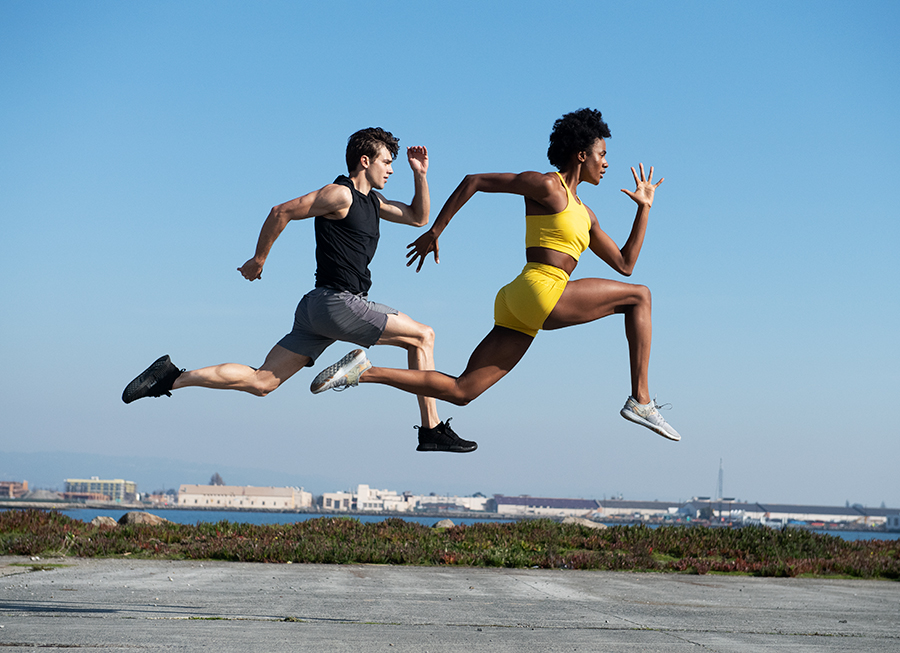 athletic duo jumping photo art director