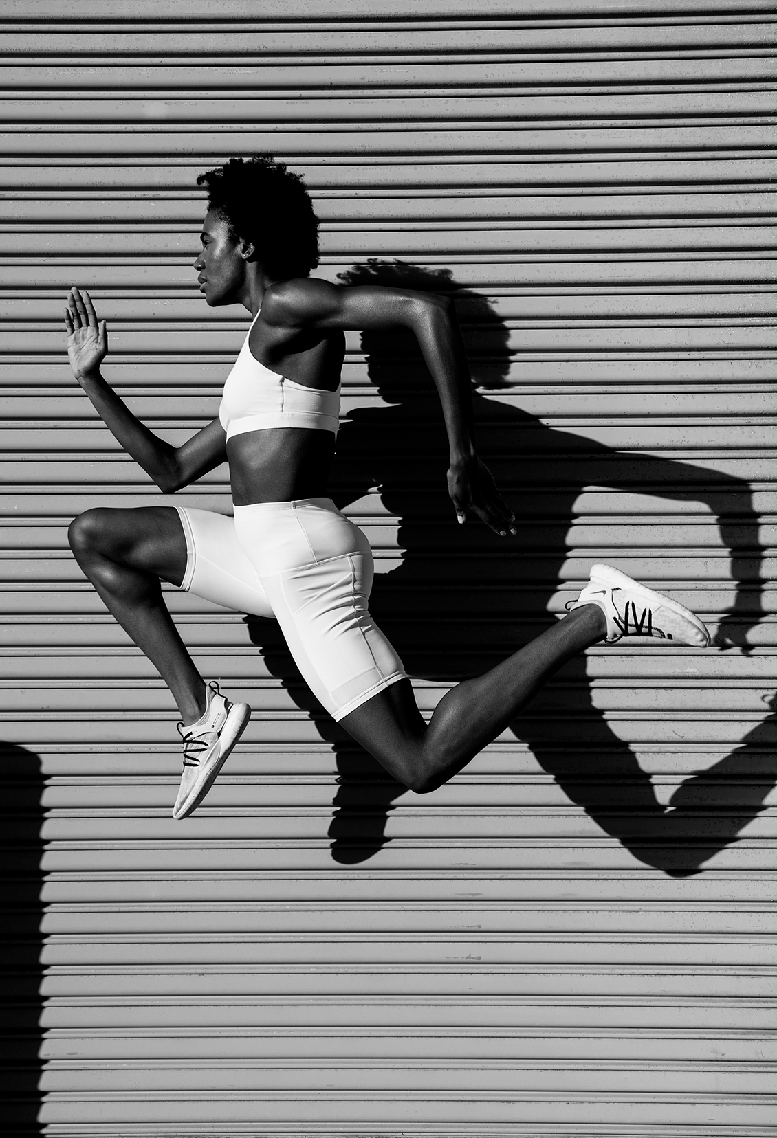 athletic woman jumping creative director photography