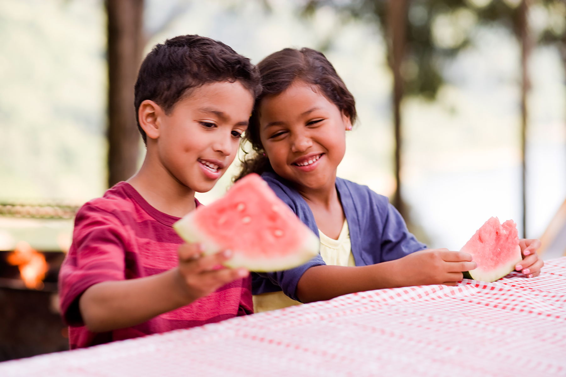 children eating at picnic table hire art director for kid