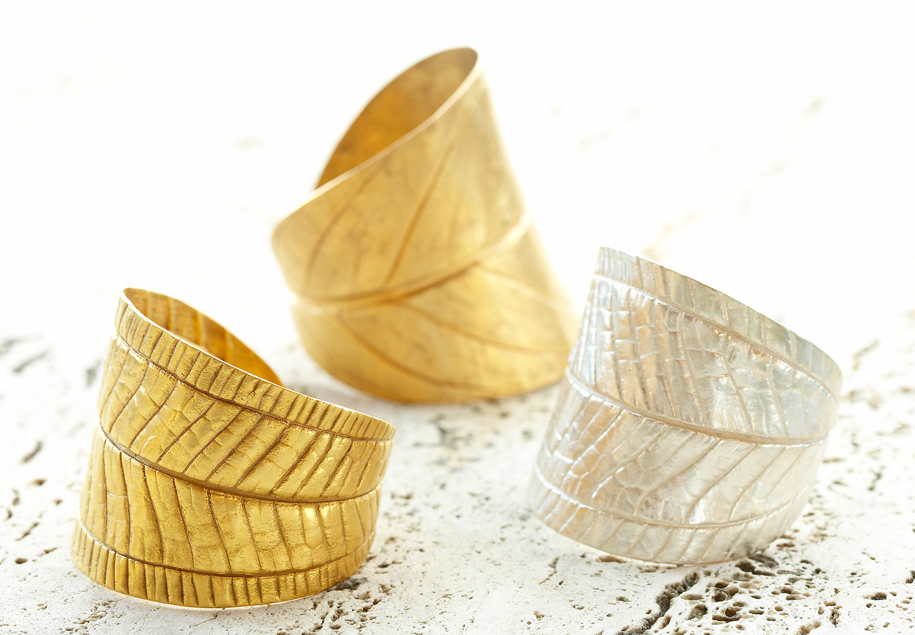 gold cuff bracelet art director for product advertising