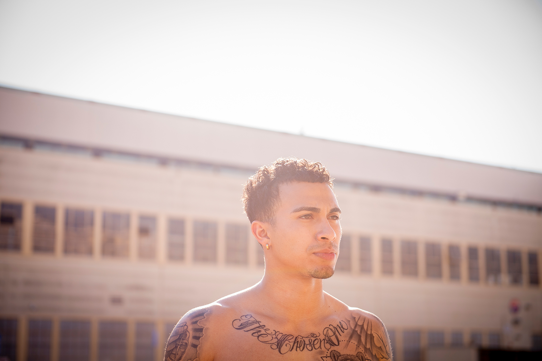 male with tattoos creative director photography