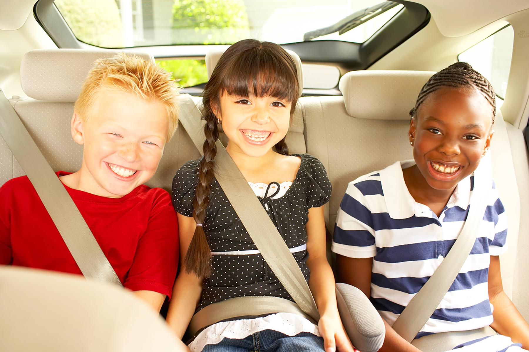 multi racial kids in car kids art director