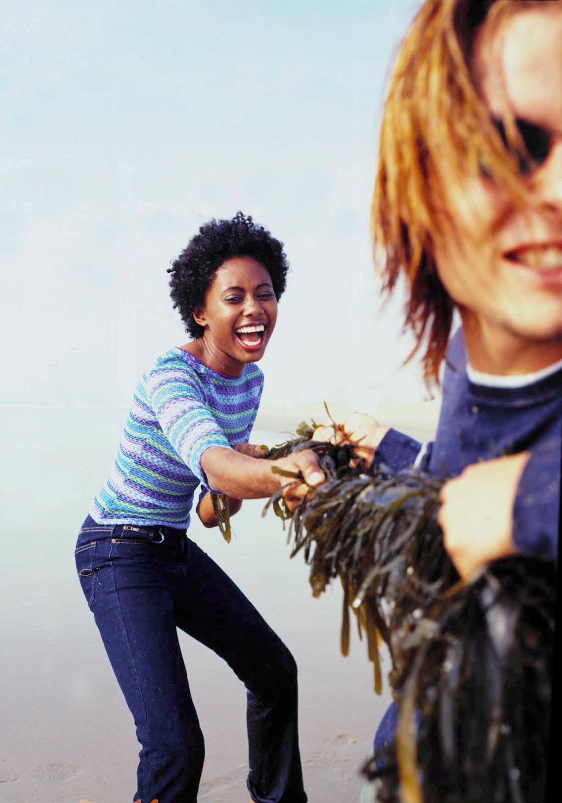 playful teens on beach photo art director
