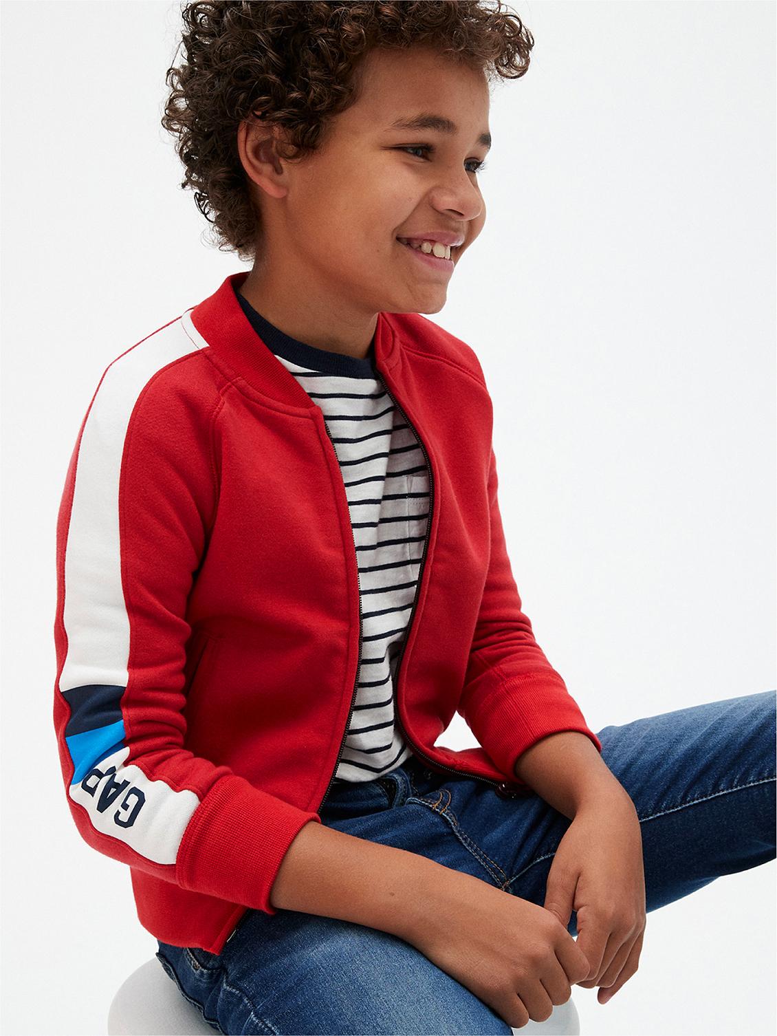 smiling boy sitting kids art director