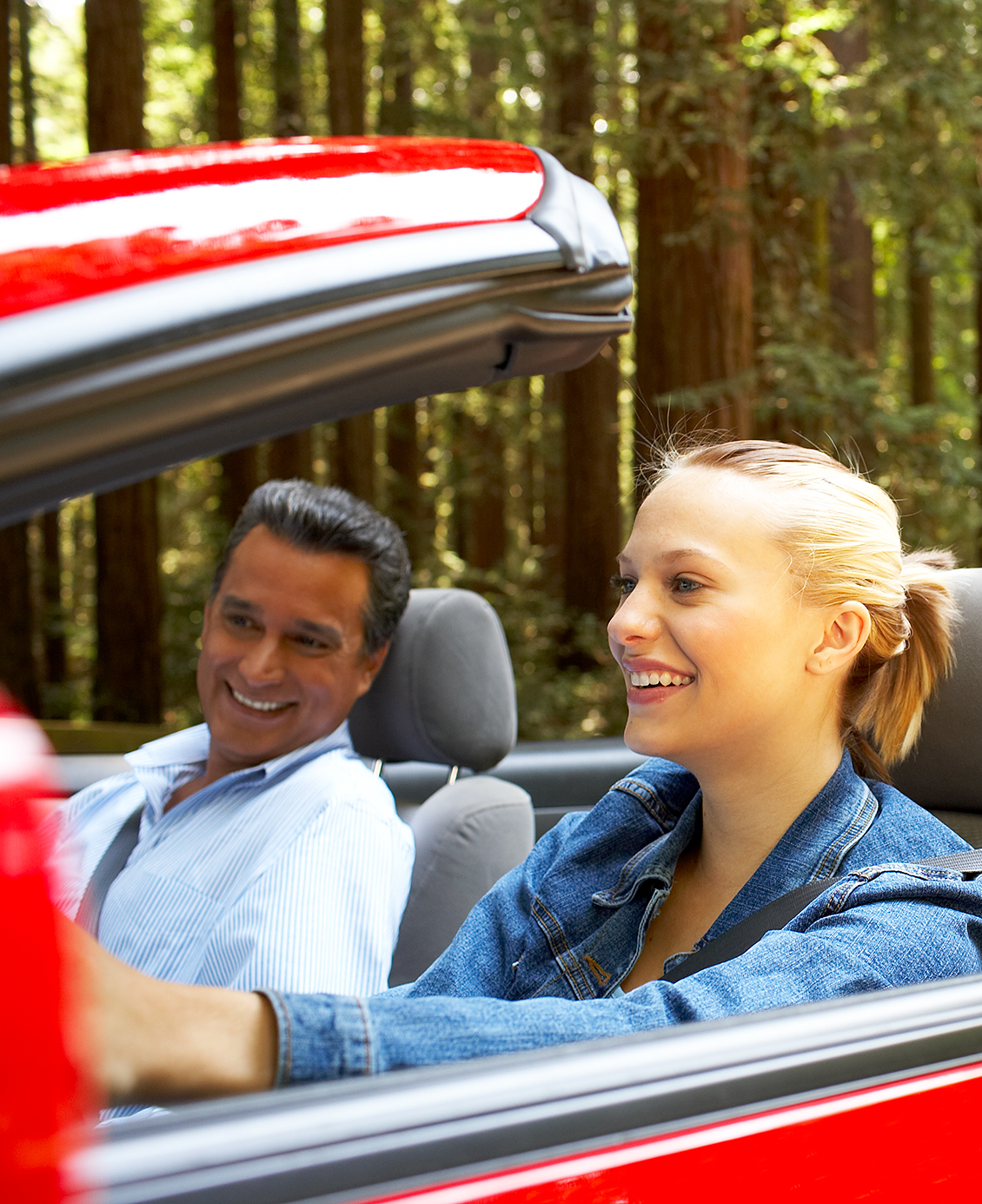 couple in red convertible brand image library