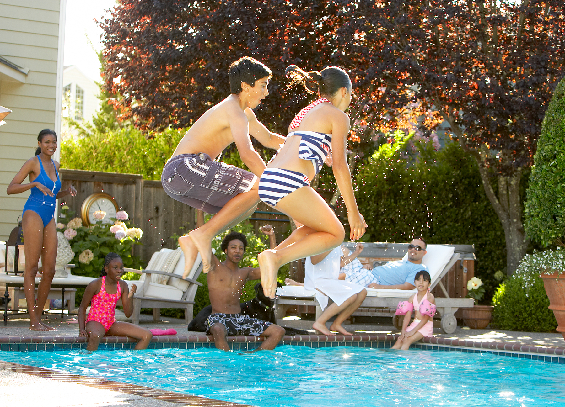 kids jumping into pool personal branding photography