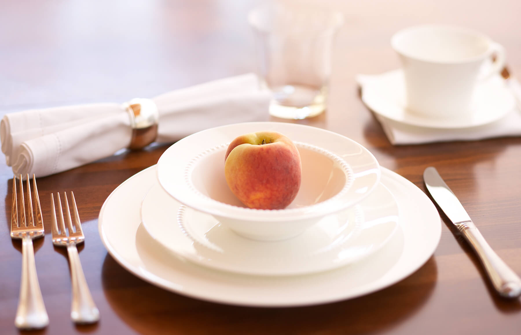 white dishes with peach best interior design photography
